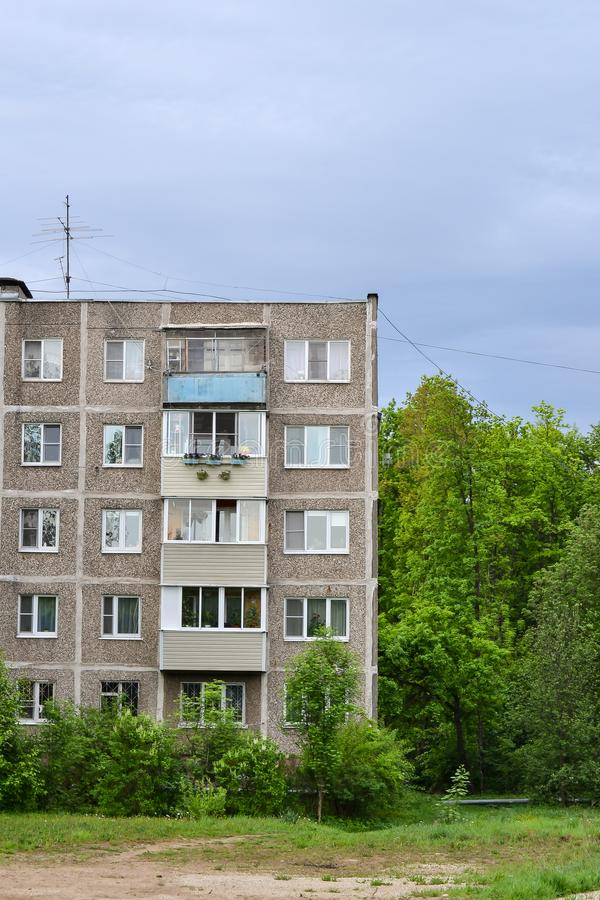 Detail of old five-story building on the outskirts in a residential area. Cheap accommodation built during the Khrushchev and Brez royalty free stock photography
