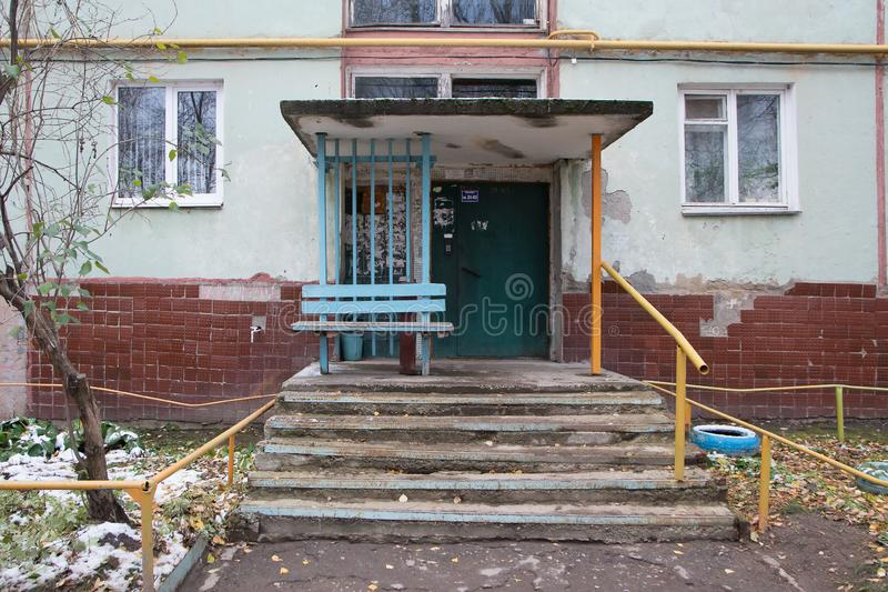 Typical entrance to a multi-apartment old house stock images